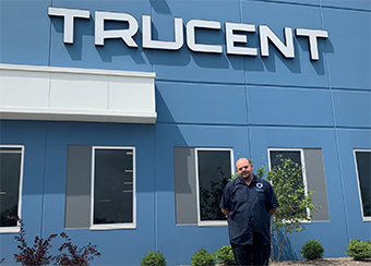 Charles Lawrence standing in front of Trucent building